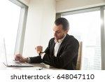 office worker at desk looking... | Shutterstock . vector #648047110