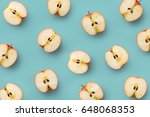 apple slices pattern on a blue...   Shutterstock . vector #648068353