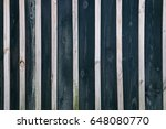 Small photo of A wooden background with alternating boards of dark color and light bars