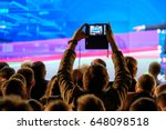 man takes a picture of the... | Shutterstock . vector #648098518