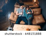 young couple smoking hookah on... | Shutterstock . vector #648151888