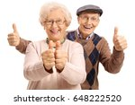 overjoyed seniors holding their ... | Shutterstock . vector #648222520