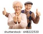overjoyed seniors holding their ... | Shutterstock . vector #648222520