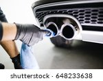 a man cleaning car exhaust with ...   Shutterstock . vector #648233638