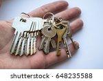 a bunch of door keys on hand | Shutterstock . vector #648235588