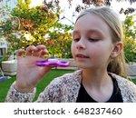 girl  holding popular fidget... | Shutterstock . vector #648237460