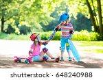 children riding skateboard in... | Shutterstock . vector #648240988