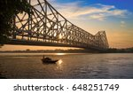 wooden boat passing the... | Shutterstock . vector #648251749