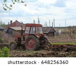 the tractor plows the earth | Shutterstock . vector #648256360
