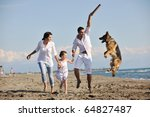 Stock photo happy young family in white clothing have fun and play with beautiful dog at vacations on beautiful 64827487