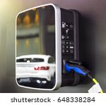 electric car charging on... | Shutterstock . vector #648338284