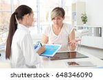 orthopedist examining middle... | Shutterstock . vector #648346090