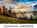 evening fog in forest on a hill. dramatic sky in autumn at sunset - stock photo