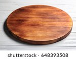 round wooden plate on table   Shutterstock . vector #648393508
