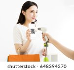 young woman pay by smart phone... | Shutterstock . vector #648394270