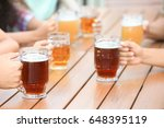 people drinking beer in cafe | Shutterstock . vector #648395119