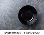 empty black soup plate on dark... | Shutterstock . vector #648401920