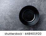 empty black soup plate on dark... | Shutterstock . vector #648401920