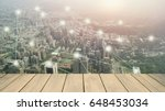 wood background with city and... | Shutterstock . vector #648453034