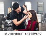 cool male in hat make up artist ... | Shutterstock . vector #648459640