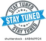 stay tuned round grunge ribbon... | Shutterstock .eps vector #648469924
