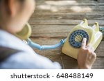 Woman Using And Dialing A...