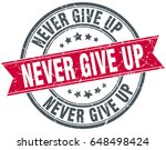 never give up round grunge... | Shutterstock .eps vector #648498424