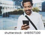 happy young african american... | Shutterstock . vector #648507100