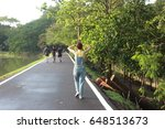 Small photo of Relaxed woman enjoying freedom and life an a beautiful