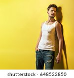 handsome young man leaning on...   Shutterstock . vector #648522850