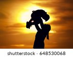 silhouette of young mother... | Shutterstock . vector #648530068