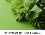 fresh green salad in selected... | Shutterstock . vector #648535030