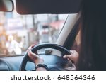 woman holding on black steering ... | Shutterstock . vector #648564346