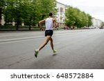 blurred motion runner man... | Shutterstock . vector #648572884