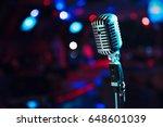 retro microphone against blur... | Shutterstock . vector #648601039