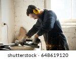 worker in workwear  protective... | Shutterstock . vector #648619120