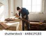 worker cutting metal plank with ... | Shutterstock . vector #648619183