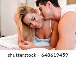 sensual foreplay by couple | Shutterstock . vector #648619459