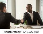 two multicultural businessmen...   Shutterstock . vector #648622450