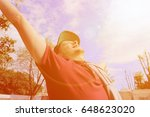 the young man raised his arms... | Shutterstock . vector #648623020