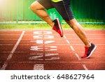 athlete crossing finish line... | Shutterstock . vector #648627964