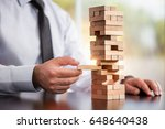 businessman building up tower ... | Shutterstock . vector #648640438