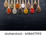 colorful spices in wooden spoon ... | Shutterstock . vector #648647593