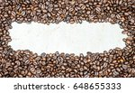 coffee beans on wood background  | Shutterstock . vector #648655333