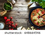 pizza on wood with ingredients. ... | Shutterstock . vector #648664546