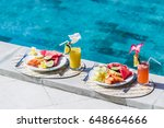two plates with fresh fruit and ... | Shutterstock . vector #648664666