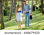 romantic couple walking forest | Shutterstock . vector #648679420