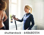 cosmetologist using aerograph... | Shutterstock . vector #648680554