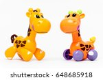 two plastic toy giraffes on a... | Shutterstock . vector #648685918