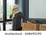 adult business woman is talking ... | Shutterstock . vector #648690190